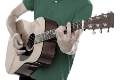 """Male Playing Guitar"" by stockimages / FreeDigitalPhotos.net"